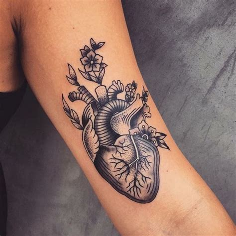 traditional heart tattoo designs black ink traditional real on left bicep