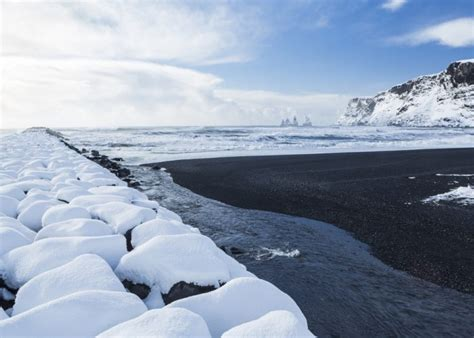 black sand beach iceland 10 beaches you have to see in winter smartertravel