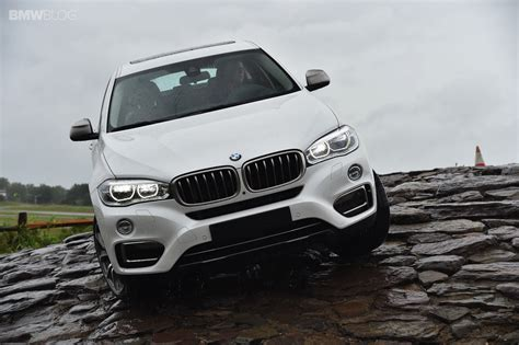 bmw road new bmw x6 goes off road in the rain