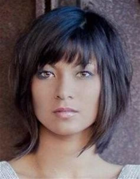 above shoulder shag layered bob with bangs shag haircuts for women over 50 short shag hairstyles