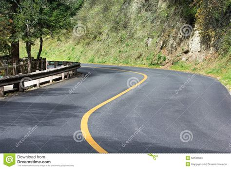 curved road with trees on both sides stock photo colourbox road curve stock photo image 52135683