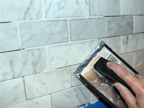 how to grout backsplash tile how to install a marble tile backsplash hgtv