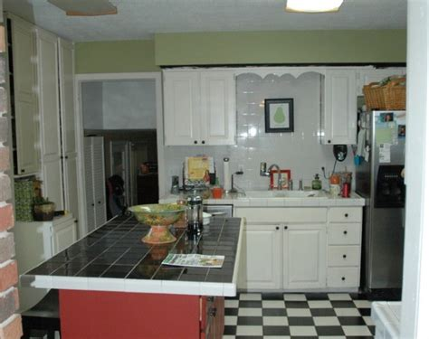 painting kitchen cabinets two colors can you paint kitchen cabinets two colors in a small