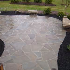 this irregular flagstone patio is wet set with mortar joints specially selected boulders are