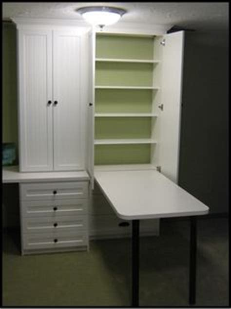 craft cabinet with fold down table this fold down craft table and storage unit is the perfect