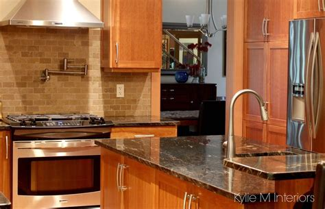 cherry wood kitchen cabinets with black granite cherry cabinets in kitchen with black granite