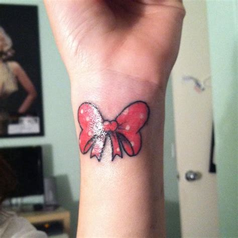tattoo on wrist swollen it s swollen but my first tattoo minnie mouse