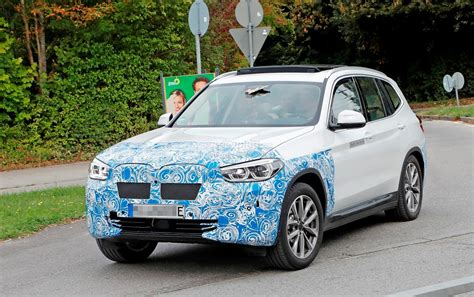 bmw ix electric suv spied flaunting yellow wiring
