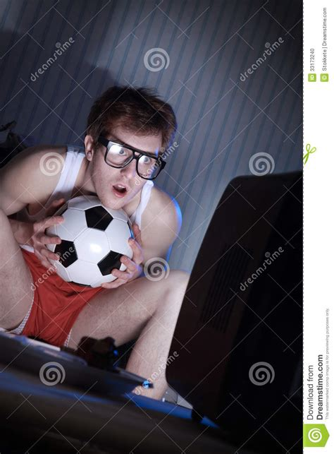 what to get a soccer fan soccer fan watching television stock photo image 33173240