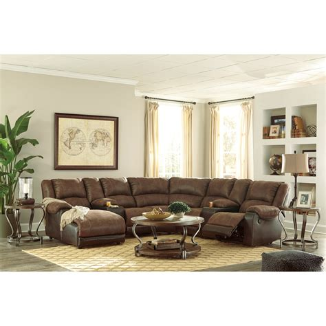 signature design sectional signature design by ashley nantahala faux leather