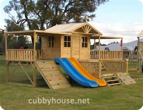 cubby house with slide and swings the benefits of swings slides and monkey bars for kids
