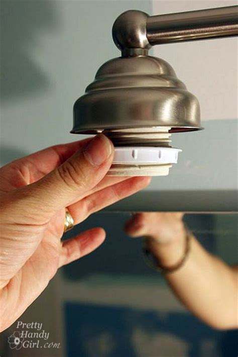 how to remove bathroom light fixture changing out a light fixture bye bye hollywood strip