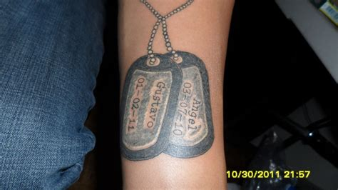 cross with dog tags tattoo tag by mjmtattoos on deviantart tattoomagz
