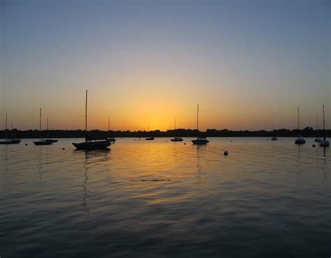 boat dock marina high rock lake free images landscape sea horizon dock sky sun