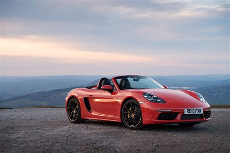 red porsche convertible red car convertible porsche 718 boxster on the background