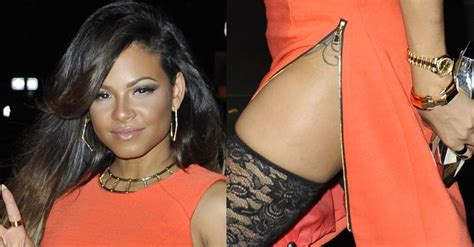 christina milian tattoo milian flaunts thigh in lace the