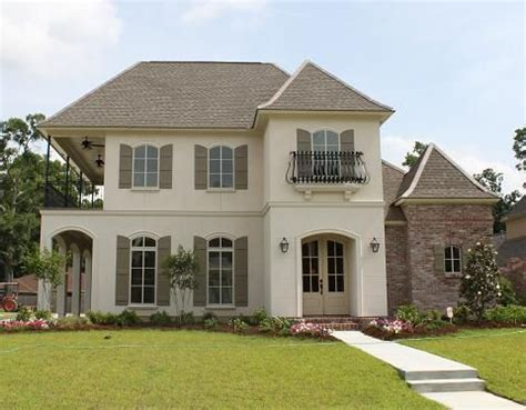 Chateau Lille Stucco With Taupe Shutters Black Wrought