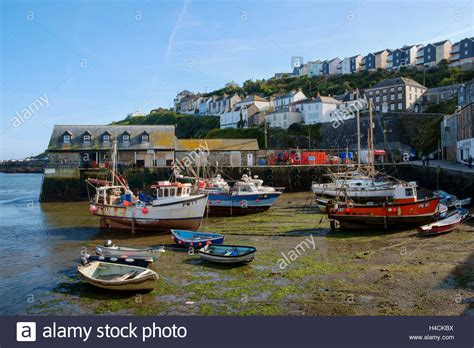 boats england mevagissey harbour with fishing boats at low tide