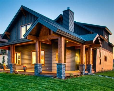 wood siding house timber porch frame stone wrapped bases black fascia vertical siding on upper level