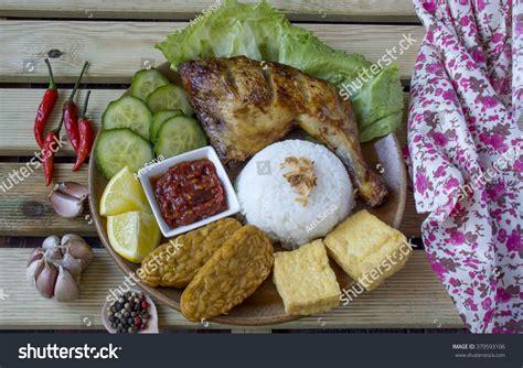 Iconic Indonesia Cookbook plate delicious ayam penyet sambal belacan stock photo 379593106