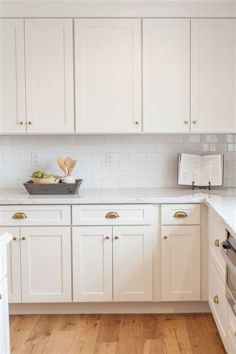 Knobs Or Handles On Kitchen Cabinets Aged Brass Hardware Kitchens Pinterest White Cabinets Marble Worktops And Cabinets