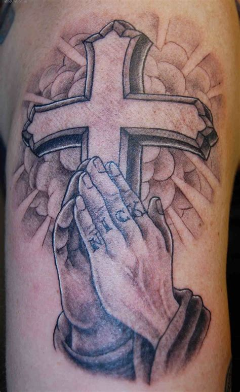 cross with prayer hands tattoo 40 amazing religious christian tattoos