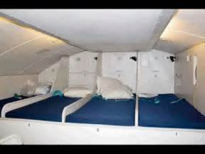 where does cabin crew sleep in passenger airplane