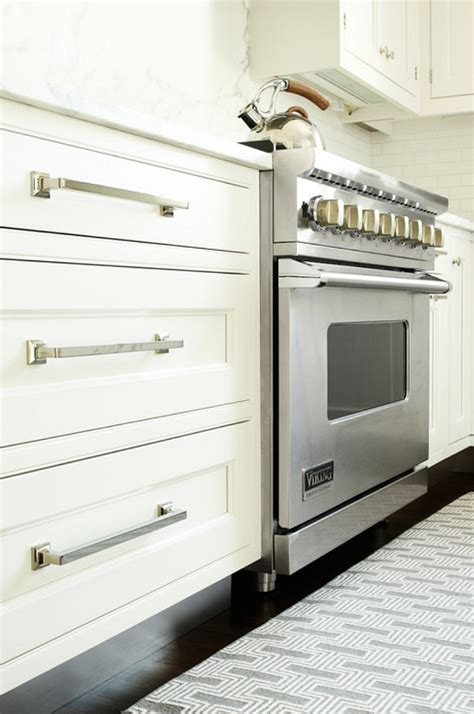 knobs or handles on kitchen cabinets transitional white kitchen home bunch interior design ideas