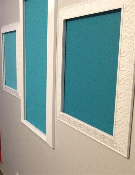 chalkboard paint in ombr 233 teal on wall framed by repainted repurposed picture frames