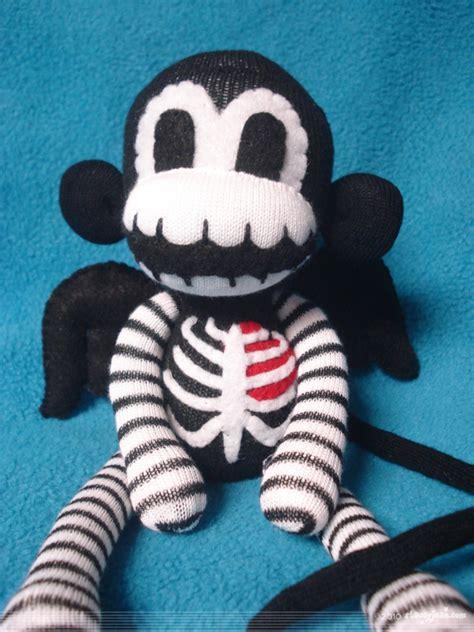 sock monkeys by winged skeleton sock monkey by rebelalamode on deviantart
