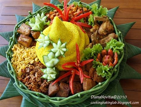 Nasi Tumpeng nasi tumpeng is a cone shaped rice dish like mountain with its side dishes vegetables and