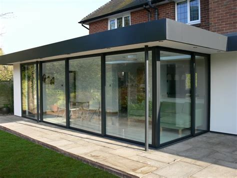 Glass Bifold Exterior Doors Glass Patio Enclosure Flat Roof House Patio Patio Enclosures Bifold Exterior