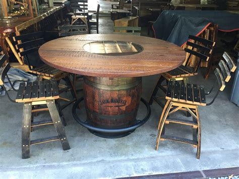 whiskey barrel table and 6 stools