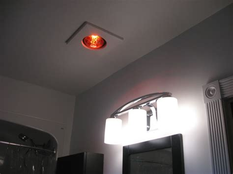 bathroom heat light bulb how to heat a small bathroom without sending your electric
