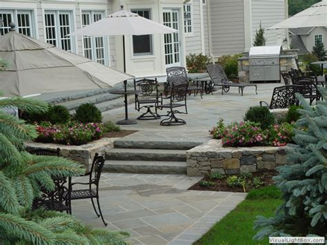 raised concrete patio design ideas raised patio with outdoor kitchen and fireplace in new