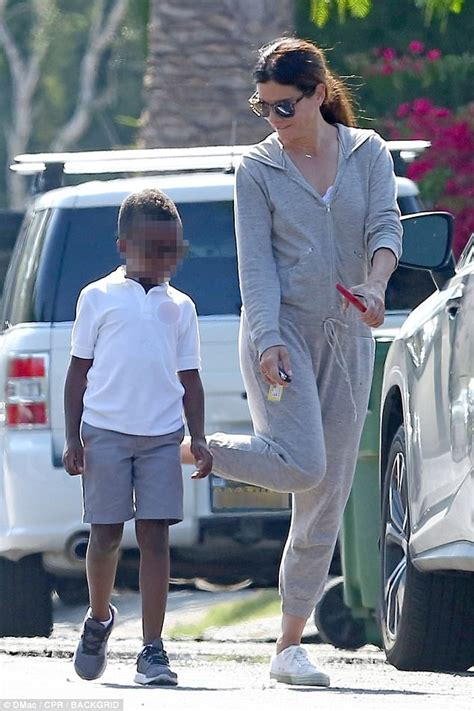 sandra bullock son sandra bullock gives her son louis an affectionate pat