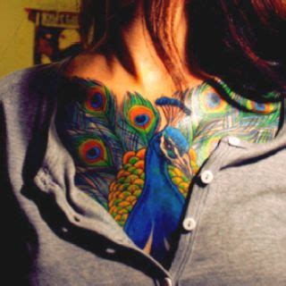 tattoo nightmares peacock beautiful ribs and colors on pinterest