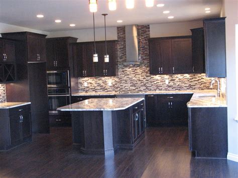 Island Style Kitchen by Netuno Bordeaux Granite On Cherry Espresso Cabinets