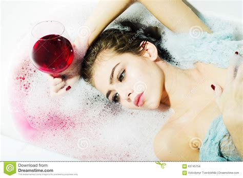 sexy bathtub closeup of woman with glass in bath stock photo image