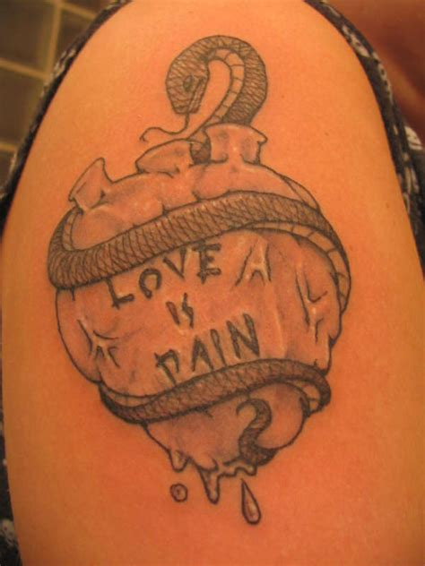 love is pain tattoos on the ribs