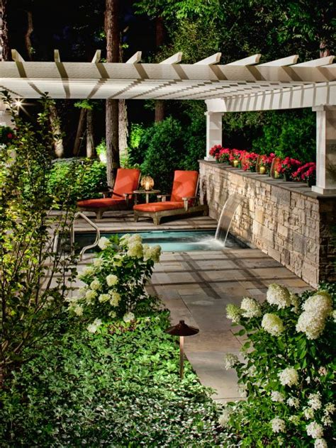 traditional stone patio  spa  neutral pergola hgtv