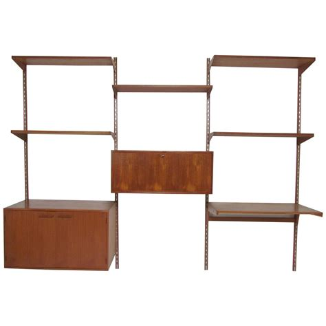 wall mounted shelving units teak quot cado quot style wall mounted shelving unit by kristiansen at 1stdibs