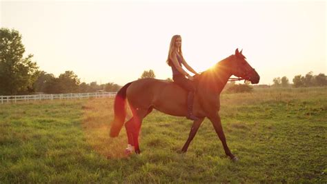 commercial girl riding horse slow motion close up beautiful young caucasian blonde