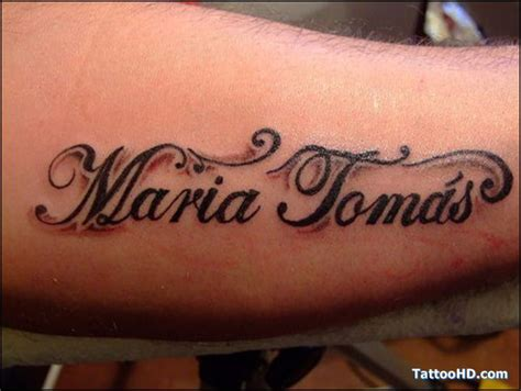 12 name tattoos on arm