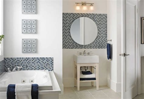 Remodeled modern bathroom with accent tiles and round mirror