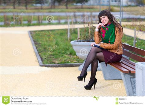 girl sitting on a bench girl sitting on the bench stock images image 34453974