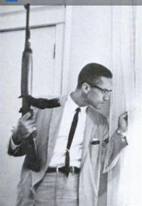 malcolm x figure malcolm x picture holding a m1 carbine rifle