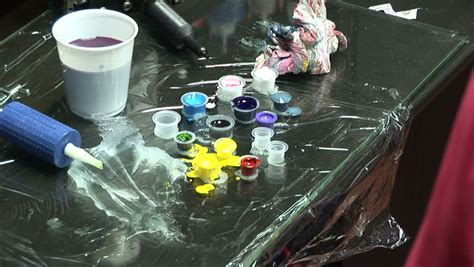 hd tattoo ink tattoo artist wipes the skin and adds more color to a