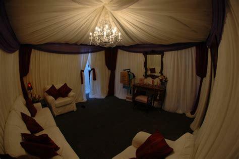 Off white chiffon full canopy drape with medium crystal chandelier bella vista designs