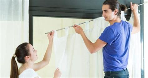 the right way to hang curtains everyone should learn how to hang curtains in the right